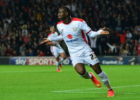 Easy, easy, easy, easy Benik Afobe reacts after making it 3-nil to the host side.