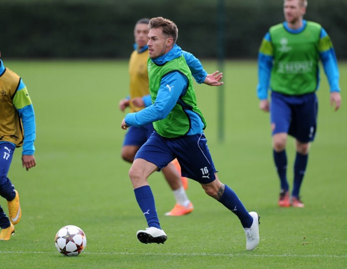 Ramsey in what we now know is a New Balance boot in training (h/t arsenal.com)